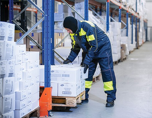 man working inside a freezer and cold storage facility
