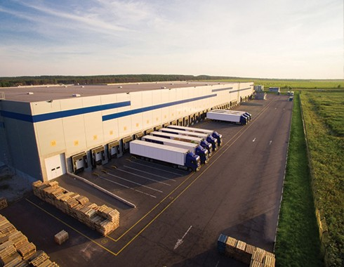 warehouse and distribution facility with trucking fleet